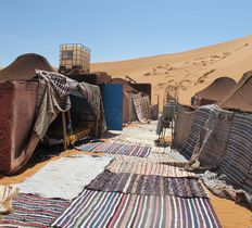 Spend a night or two at a real desert camp in the giant dunes of Merzouga near E
